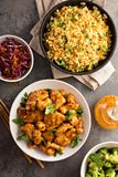 Spicy sweet and sour chicken with rice and cabbage. Spicy sweet and sour general tso chicken with fried rice and purple cabbage overhead shot Royalty Free Stock Photo