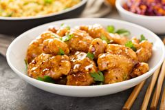 Spicy sweet and sour chicken with rice and cabbage. Spicy sweet and sour general tso chicken with fried rice and purple cabbage Royalty Free Stock Photography