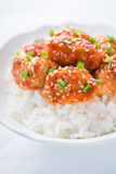 Spicy sweet and sour chicken with sesame and rice close up. Oriental food Stock Image