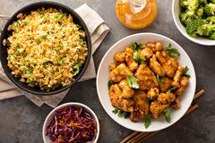 Spicy sweet and sour chicken with rice and cabbage. Spicy sweet and sour general tso chicken with fried rice and purple cabbage overhead shot Royalty Free Stock Photography