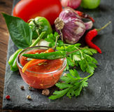 Spicy sweet tomato sauce with onion, garlic Royalty Free Stock Photos