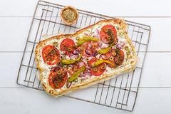 Spicy tarte flambee with pepperoni and olives Royalty Free Stock Photos