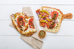 Spicy tarte flambee with pepperoni and olives Royalty Free Stock Photography