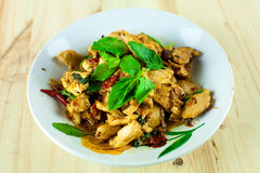 Spicy Thai basil chicken ready to eat on traditional plate. Royalty Free Stock Image