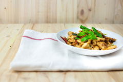 Spicy Thai basil chicken ready to eat on traditional plate. (Shallow aperture intended for  the aesthetic quality of the blur Stock Photography