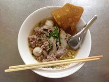 Spicy thai egg noodle with pork and fishball Stock Images