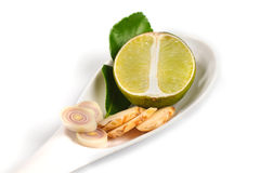 Spicy Thai food ingredients  lime,ginger, kaffir ,lemongrass in spoon isolated on white Stock Photos