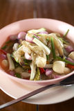 Spicy thaifood from shrimp. Spicy shrimp salad on wood table Royalty Free Stock Image