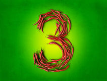 Spicy three on green Royalty Free Stock Photos