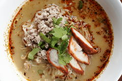 Spicy TOM YAM noodle soup with pork, lemongrass, chili pasted and lime juice Stock Photos