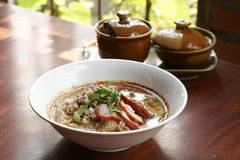 Spicy TOM YAM noodle soup with pork, lemongrass, chili pasted and lime juice Stock Images