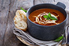 Spicy tomato cream soup with bread Stock Photo