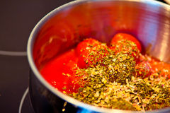 Spicy tomato sauce in the making Stock Photos