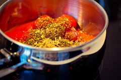 Spicy tomato sauce in the making Royalty Free Stock Image