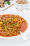 Spicy tomato soup with green lentils and vegetables in a plate Stock Photo