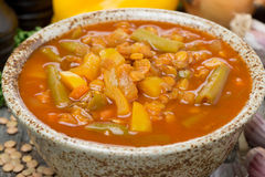 Spicy tomato soup with lentils and vegetables, close-up Stock Photography