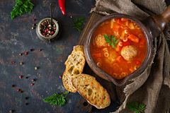 Spicy tomato soup with meatballs, pasta and vegetables. Healthy dinner. Top view stock photos