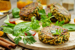 Spicy vegan curry burgers with millet, chickpeas and herbs Stock Images