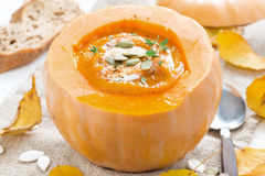 Spicy vegetable cream soup in a pumpkin, close-up Royalty Free Stock Photography