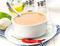 Spicy vegetable soup with chili, on wooden board Stock Photos
