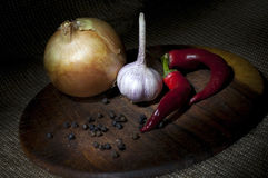 Spicy vegetables on cutting board Royalty Free Stock Photos
