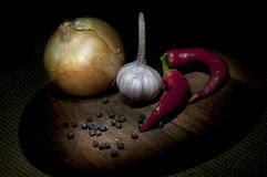 Spicy vegetables on cutting board Royalty Free Stock Photo