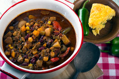 Spicy vegetarian chili. With a slice of cheddar cornbread Royalty Free Stock Images