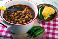 Spicy vegetarian chili. With a slice of cheddar cornbread Royalty Free Stock Photography