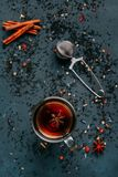 Spicy warming black tea in a glass cup with anise, cinnamon, tea stock images