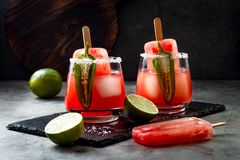 Spicy watermelon popsicle margarita cocktail with jalapeno and lime. Mexican alcoholic drink for Cinco de mayo party. Spicy watermelon popsicle margarita royalty free stock image