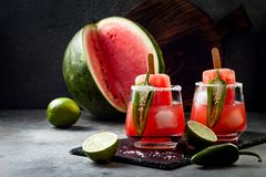 Spicy watermelon popsicle margarita cocktail with jalapeno and lime. Mexican alcoholic drink for Cinco de mayo party. Spicy watermelon popsicle margarita stock photo
