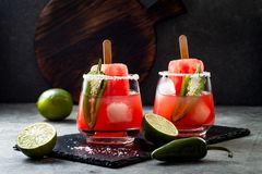 Spicy watermelon popsicle margarita cocktail with jalapeno and lime. Mexican alcoholic drink for Cinco de mayo party. Spicy watermelon popsicle margarita stock photos