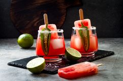 Spicy watermelon popsicle margarita cocktail with jalapeno and lime. Mexican alcoholic drink for Cinco de mayo party. Spicy watermelon popsicle margarita stock image