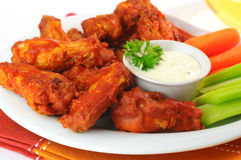 Spicy Wings. Hot and spicy buffalo chicken wings with fresh vegetables Stock Photography
