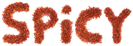 Spicy written with chilli peppers Stock Images
