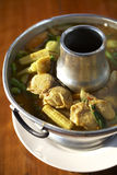 Spicy yellow fish soup. In sunlight Stock Photo