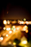 Spider backlit by a bokeh of city lights. Spider backlit by a colorful glow and bokeh of city lights shining in the darkness viewed as a silhouette Royalty Free Stock Photography