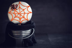 Scary halloween cup cakes. Spider cookie lollipop in basket on dark background with blank space Royalty Free Stock Image