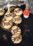 Spider cookies for Halloween party. Halloween decor for cookies like a spider. Decorative dessert idea Royalty Free Stock Photography