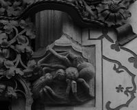 Spider and fly face to face. Shot in black and white, detail on the sculpture on the facade of this historic building representing some characters / animals / Royalty Free Stock Images