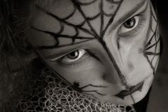 Spider girl. Girl with spider make-up in sepia tones Royalty Free Stock Images