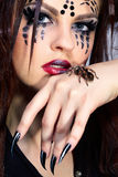 Spider-girl and Brachypelma smithi. Portrait of girl with spider Brachypelma smithi bodyart of face zone Royalty Free Stock Images