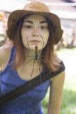 Spider and a girl's face stock photos
