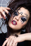 Spider girl and spider Brachypelma smithi. Portrait of girl with spider bodyart of face zone with real spider Brachypelma smithi on her hand Stock Photos