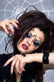 Spider girl and spider Brachypelma smithi. Portrait of girl with spider bodyart of face zone with real spider Brachypelma smithi on her hand Royalty Free Stock Images