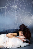 Spider girl and victim Stock Photos