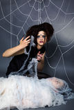 Spider girl and victim Stock Photo