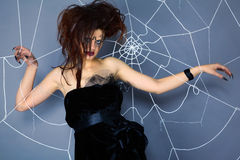 Spider girl and web Stock Photo