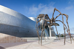Spider at the Guggenheim Museum Bilbao. Bilbao, Spain, June 16, 2012: Bronze sculpture, steel and marble, seen from below, and located at the rear of the Royalty Free Stock Photo