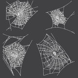 Spider hand drawn net set. On black background Royalty Free Stock Images